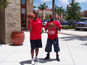 Eric Hollis of Boynton Beach, FL enjoys some time with FAU Coach Mike Jarvis II